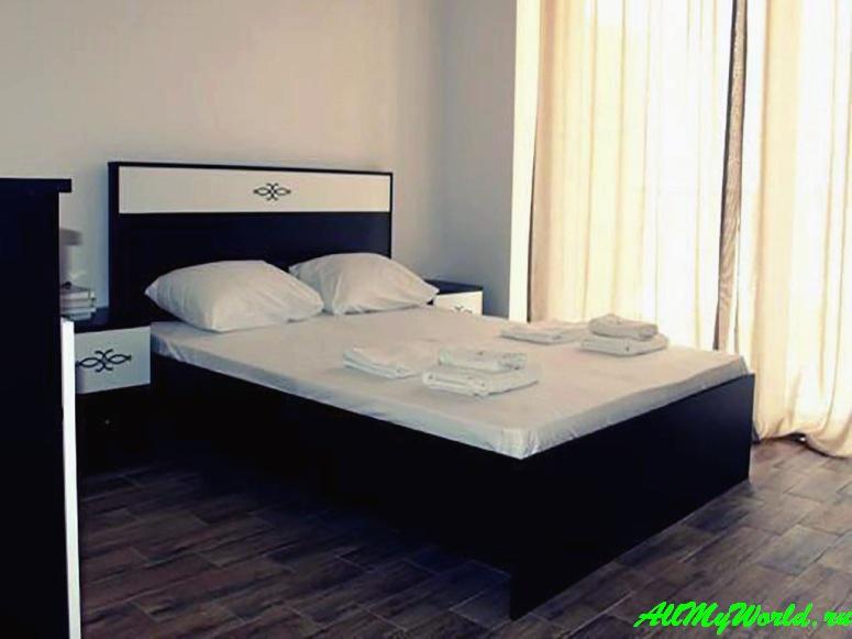 Отели и апартаменты Квариати - Guest House Achi